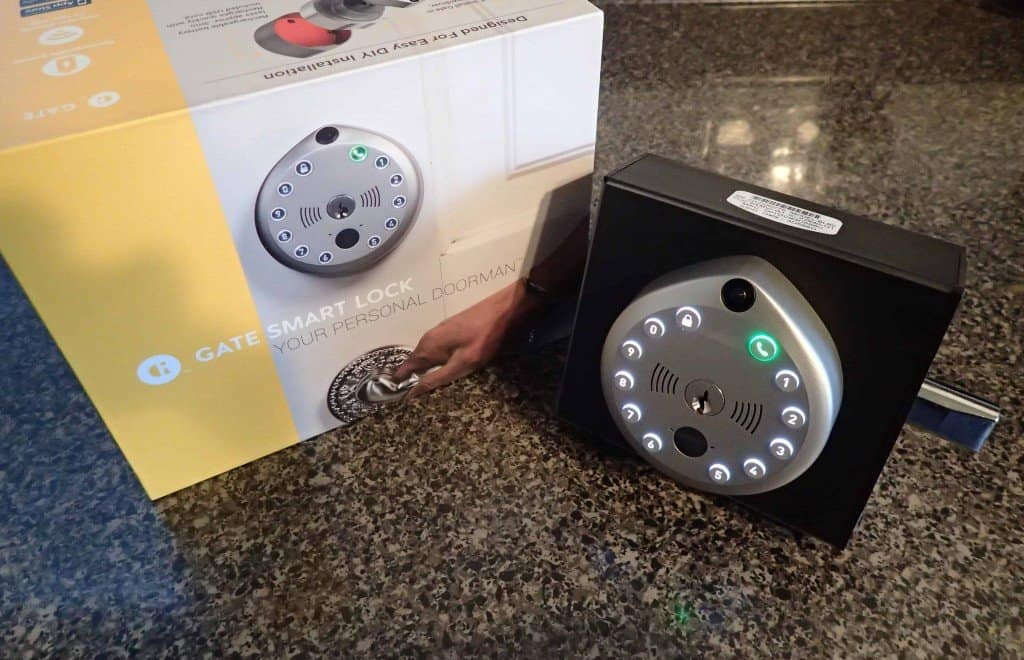 gate smart lock displayed on test block next to packaging