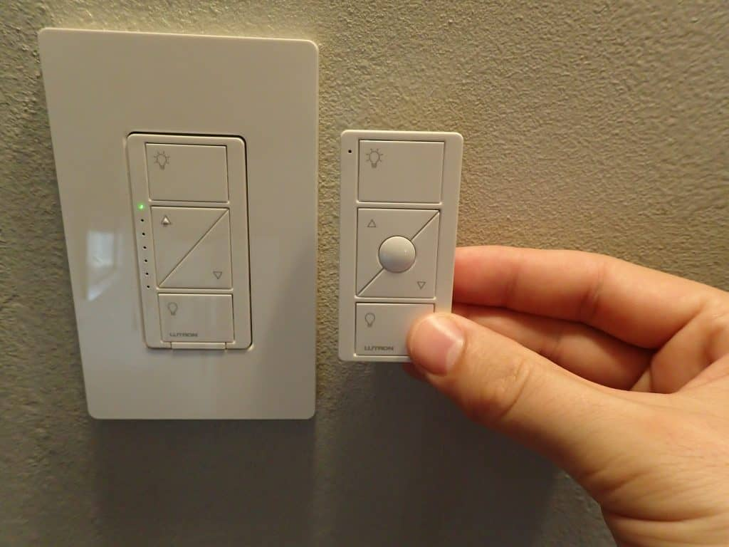 lutron pico remote with favorite button next to dimmer switch